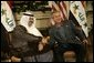 President George W. Bush shakes hands with new Iraqi President Ghazi al-Yawer at the G8 Summit on Sea Island, Ga., Wednesday, June 9, 2004. White House photo by Eric Draper.