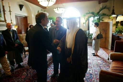 President George W. Bush looks on as Britain's Prime Minister Tony Blair and Iraq's new interim President Ghazi al-Yawer greet each other at the G8 Summit on Sea Island, Ga., Wednesday, June 9, 2004.