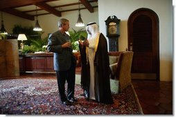 President George W. Bush and Iraq's new interim President Ghazi al-Yawer talk at the G-8 Summit on Sea Island, Ga., Wednesday, June 9, 2004.  White House photo by Eric Draper