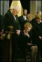Vice President Dick Cheney, Nancy Reagan and other mourners bow their heads during the State Funeral Ceremony in the Rotunda of the U.S. Capitol Wednesday, June 9, 2004. White House photo by David Bohrer.