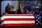 President George W. Bush and Laura Bush pay their final respects at the casket containing the body of former President Ronald Reagan in the U.S. Capitol Rotunda, Thursday, June 10, 2004. White House photo by Eric Draper.