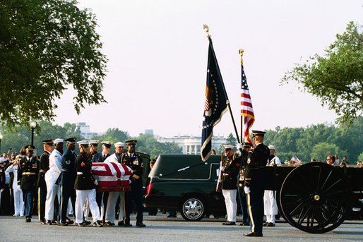 Former President Ronald Reagan's casket is transfered onto horse-drawn caisson at 1600 Constitution Avenue near the White House, Wednesday, June 9, 2004. White House photo by Joyce Naltchayan.