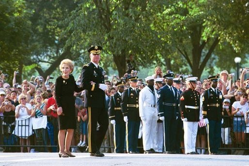 Nancy Reagan looks on as former President Ronald Reagan's casket is transfered onto a horse-drawn caisson at 1600 Constitution Avenue near the White House , Wednesday, June 9, 2004. White House photo by Joyce Naltchayan.