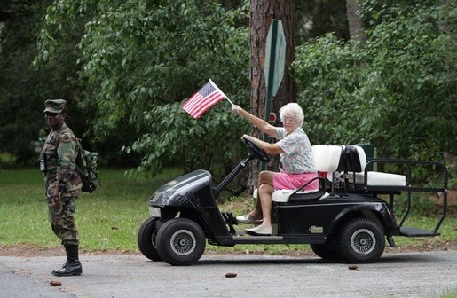 A women waves an American flag at the G8 Summit on Sea Island, Ga., Wednesday, June 9, 2004. White House photo by Eric Draper.