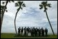 Leaders of G8 countries, European officials and guests pose at the beach for a group photo at the G8 Summit in Sea Island, Ga., Wednesday, June 9, 2004. White House photo by Eric Draper.
