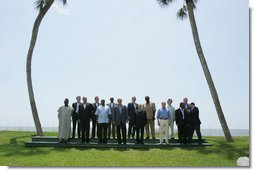 President George W. Bush and G8 Summit leaders pose with African leaders at Ocean Forest during the last day of the Summit at Sea Island, Ga., Thursday, June 10, 2004. Leaders from Algeria, Ghana, Senegal, Nigeria, South Africa, Uganda attended the last day of the summit.  White House photo by Paul Morse