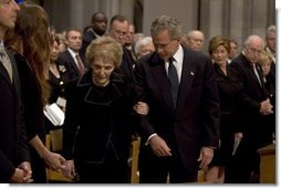 President George W. Bush escorts former First Lady Nancy Reagan to her seat before the funeral service for former President Ronald Reagan at the National Cathedral in Washington, DC on June 11, 2004.  White House photo by Paul Morse
