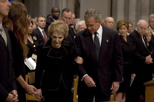 President George W. Bush escorts former First Lady Nancy Reagan to her seat before the funeral service for former President Ronald Reagan at the National Cathedral in Washington, DC on June 11, 2004. White House photo by Paul Morse.