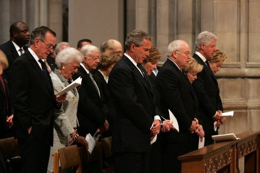 President George W. Bush bows his head during a prayer reading during the funeral service for former President Ronald Reagan at the National Cathedral in Washington, DC on June 11, 2004. White House photo by Paul Morse.