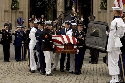 The casket of former President Ronald Reagan is loaded into a hearse at the funeral service at the National Cathedral in Washington, DC on June 11, 2004. White House photo by Paul Morse.