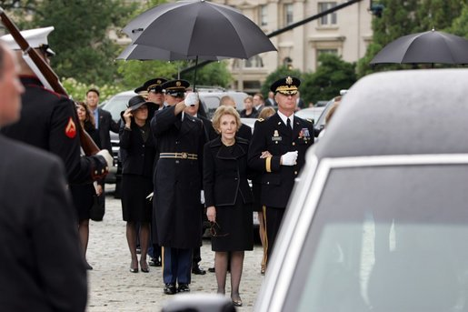Former First Lady Nancy Reagan watches the casket of former President Ronald Reagan being loaded into a hearse at the funeral service at the National Cathedral in Washington, DC on June 11, 2004. White House photo by Paul Morse.