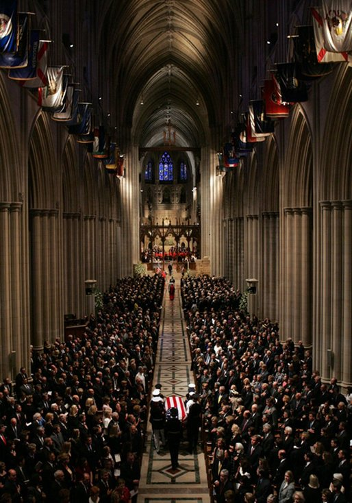 Former President Ronald Reagan's casket is carried out of the National Cathedral after the National Funeral Service in Washington, D.C., Friday, June 11, 2004. White House photo by Tina Hager.