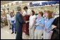 President George W. Bush greets shoppers at the Hy-Vee grocery and pharmacy store in Liberty, Mo., June 14, 2004. White House photo by Paul Morse