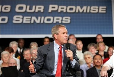 President George W. Bush makes a point during a conversation on Medicare-approved prescription drug discount cards in Liberty, Mo., June 14, 2004.