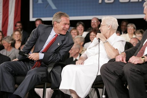 President George W. Bush laughs with senior Wanda Blackmore during a conversation on Medicare-approved prescription drug discount cards in Liberty, Mo., June 14, 2004. White House photo by Paul Morse