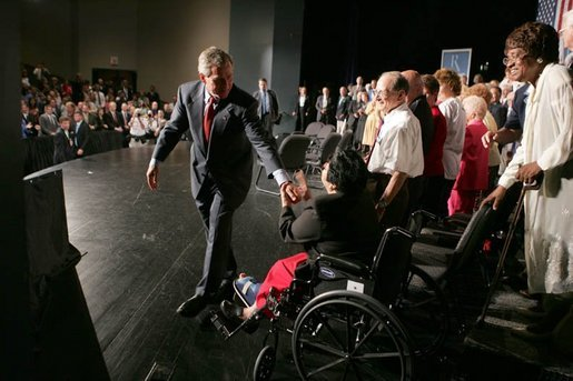 HP8C1942.jpg President George W. Bush greets seniors after a conversation on Medicare-approved prescription drug discount cards in Liberty, Mo., June 14, 2004. White House photo by Paul Morse