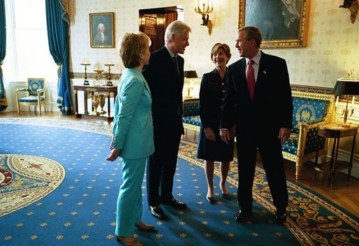 President George W. Bush and Laura Bush talk with former President Bill Clinton and Senator Hillary Clinton in the Blue Room shortly before the unveiling of the Clinton portraits in the East Room of the White House Monday, June 14, 2004. White House photo by Paul Morse
