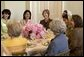 Laura Bush hosts a luncheon for the U.S.-Afghan Women's Council in the Family Dining Room located in the private living quarters of the White House Tuesday, June 15, 2004. Pictured with Mrs. Bush are, clockwise from left: the Honorable Zohra Rasekh, Mrs. Shamim Jawad, Dr. Habiba Sarabi, Ms. Shukria Amani, the Honorable Shirin Tahir-Kheli, Mrs. Joyce Rumsfeld and Ms. Patricia Mitchell. White House photo by Tina Hager.