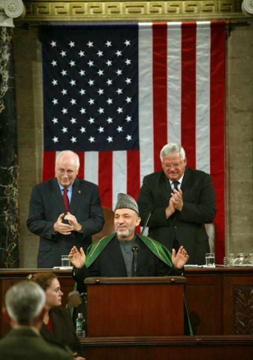Vice President Dick Cheney and Speaker of the House Dennis Hastert (R-IL), right, welcome Afghanistan President Hamid Karzai, center, before he addresses the joint meeting of Congress on Capitol Hill Tuesday, June 15, 2004. White House photo by David Bohrer.