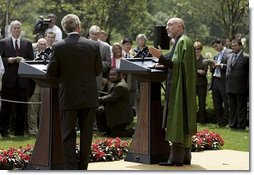 President George W. Bush and Hamid Karzai of Afghanistan hold a joint press conference in the Rose Garden Tuesday, June 15, 2004.   White House photo by Paul Morse