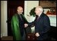 Vice President Dick Cheney greets President Hamid Karzai of Afghanistan in the Roosevelt Room in the West Wing Tuesday, June 15, 2004. White House photo by David Bohrer.