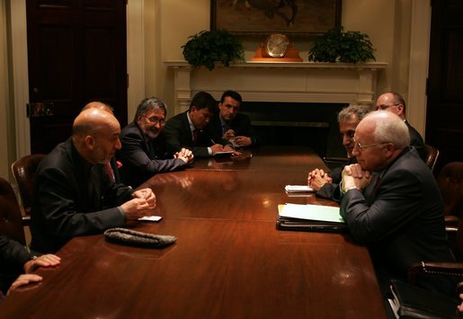 Vice President Dick Cheney meets with President Hamid Karzai of Afghanistan in the Roosevelt Room Tuesday, June 15, 2004. White House photo by David Bohrer.