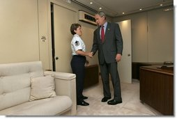 President George W. Bush meets Freedom Corps Greeter Master Sergeant Gina Carnesecchi aboard Air Force One after arriving at MacDill Air Force Base in Tampa, Florida, Wednesday, June 16, 2004. Sgt. Carnesecchi founded Operation Lighthouse, a program at MacDill AFB to support troops who are deployed overseas.  White House photo by Eric Draper