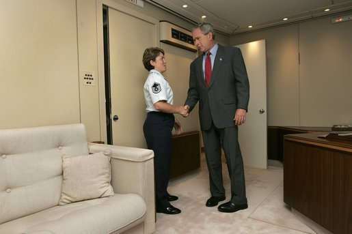 President George W. Bush meets Freedom Corps Greeter Master Sergeant Gina Carnesecchi aboard Air Force One after arriving at MacDill Air Force Base in Tampa, Florida, Wednesday, June 16, 2004. Sgt. Carnesecchi founded Operation Lighthouse, a program at MacDill AFB to support troops who are deployed overseas. White House photo by Eric Draper.