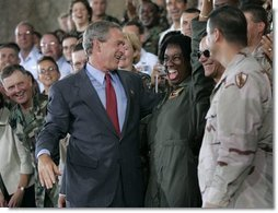President George W. Bush greets stage participants after delivering remarks to military personnel at MacDill Air Force Base in Tampa, Florida, Wednesday, June 16, 2004.   White House photo by Eric Draper