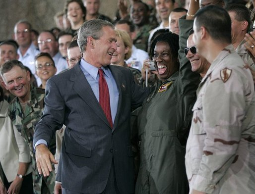 President George W. Bush greets stage participants after delivering remarks to military personnel at MacDill Air Force Base in Tampa, Florida, Wednesday, June 16, 2004. White House photo by Eric Draper.