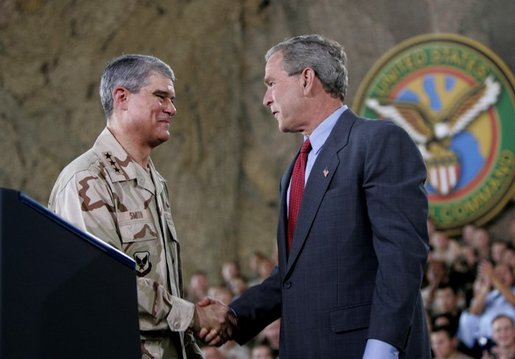 President George W. Bush greets Lieutenant General Lance Smith, Commander Central Command, before delivering remarks to military personnel at MacDill Air Force Base in Tampa, Florida, Wednesday, June 16, 2004. White House photo by Eric Draper.