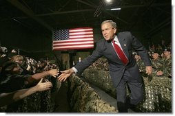 President George W. Bush greets Fort Lewis military personnel in the audience during his introduction at Fort Lewis, Washington, Friday, June 18, 2004.  White House photo by Eric Draper
