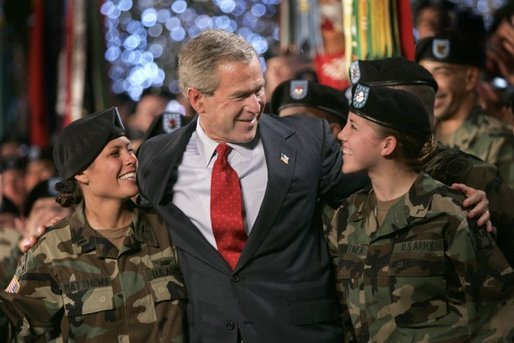 President George W. Bush joins soldiers on stage following his remarks at Fort Lewis, Washington, Friday, June 18, 2004. White House photo by Eric Draper.