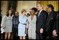 President George W. Bush and Mrs. Laura Bush pose with jazz musicians after a performance to honor Black Music Month in the East Room of the White House on June 22, 2004. White House photo by Paul Morse
