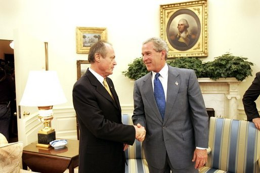 President George W. Bush shakes hands with Prime Minister Peter Medgyessy of Hungary at the end of their meeting in the Oval Office, Tuesday, June 22, 2004. White House photo by Eric Draper