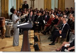 Dione Taylor sings with the Billy Taylor Trio as part of a reception for Black Music Month held in the East Room of the White House on June 22, 2004.   White House photo by Paul Morse