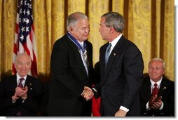 Recipient of the Presidential Medal of Freedom Senator Edward William Brooke thanks President George W. Bush after receiving his award in the East Room of the White House on June 23, 2004.  White House photo by Paul Morse