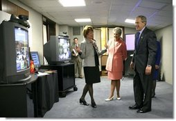 President George W. Bush views a demonstration of broadband and wireless technologies at the U.S. Department of Commerce Thursday, June 24, 2004.