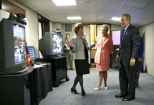 President George W. Bush views a demonstration of broadband and wireless technologies at the U.S. Department of Commerce Thursday, June 24, 2004. White House photo by Tina Hager.
