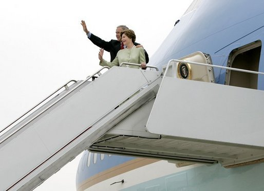 President George W. Bush and Laura Bush board Air Force One before departing Andrews Air Force Base en route to Shannon, Ireland, Friday, June 25, 2004. White House photo by Eric Draper.