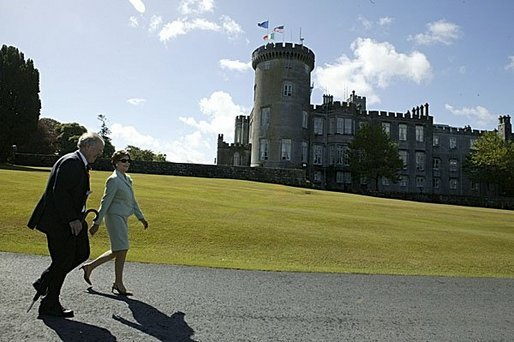 Laura Bush and Ireland's Deputy Chief of Protocol Joe Brennan walk along the grounds of Dromoland Castle during a day of meetings between the United States and European Union in Shannon, Ireland, Saturday, June 26, 2004. White House photo by Joyce Naltchayan