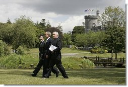 President George W. Bush walks with Prime Minister of Ireland Bertie Ahern, right, and President of the European Commission Romano Prodi on the way to their joint press conference at the Dromoland Castle in Shannon, Ireland, Saturday, June 26, 2004.  White House photo by Eric Draper
