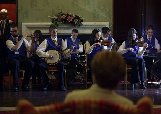 Children play traditional Irish music for Laura Bush during a performance at Dromoland Castle in Shannon, Ireland, Saturday, June 26, 2004. White House photo by Joyce Naltchayan