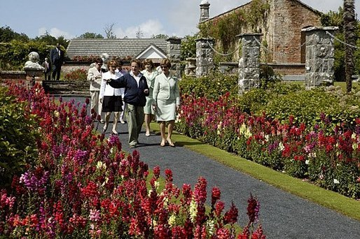 Laura Bush tours the Walled Garden of Dromoland Castle with Head Gardener Dorothea Madden in Shannon, Ireland, Saturday, June 26, 2004. White House photo by Joyce Naltchayan