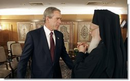 President George W. Bush talks with Ecumenical Patriarch Bartholomew I after meeting with religious leaders in Istanbul, Turkey, Sunday, June 27, 2004.  White House photo by Eric Draper