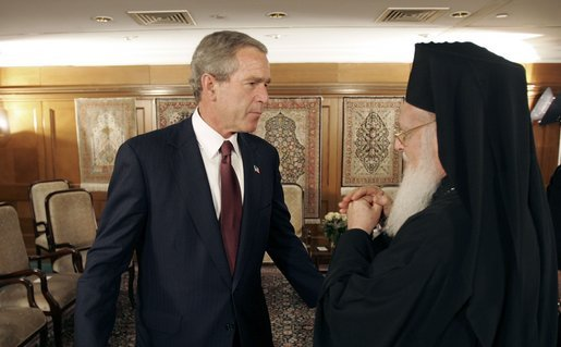 President George W. Bush talks with Ecumenical Patriarch Bartholomew I after meeting with religious leaders in Istanbul, Turkey, Sunday, June 27, 2004. White House photo by Eric Draper.
