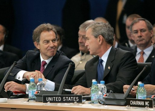 Minutes after the Coalition Provisional Authority transferred authority to Iraq's interim government, President George W. Bush and British Prime Minister Tony Blair shake hands during a work session at the NATO Summit in Istanbul, Turkey, Monday, June 28, 2004. White House photo by Eric Draper.