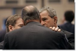 President George W. Bush talks with French President Jacques Chirac during the NATO Summit at the Istanbul Convention and Exhibition Center in Turkey, Monday, June 28, 2004.