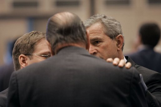 President George W. Bush talks with French President Jacques Chirac during the NATO Summit at the Istanbul Convention and Exhibition Center in Turkey, Monday, June 28, 2004. White House photo by Eric Draper.