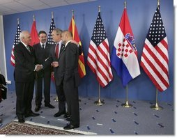 President George W. Bush talks with leaders of the Adriatic Charter Countries following a photo opportunity at the NATO Summit in Istanbul, Turkey, June 29, 2004. From left are President Alfred Moisiu of Albania, President Branko Crvenkovski of Macedonia and President Stjepan Mesic of Croatia.  White House photo by Eric Draper